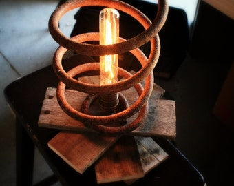 One of a kind table lamp- made from reclaimed wood and antique industrial spring