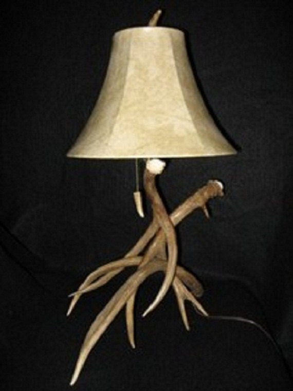 this antler lamp is handmade with three small mule deer antlers
