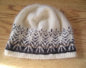 The Swan Cap Yarn only- Directions are in the book Poems of Color by Wendy Keele-Main color -Natural Cream