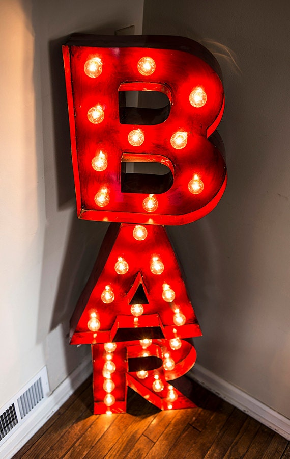 red vintage style bar sign using mottled paint