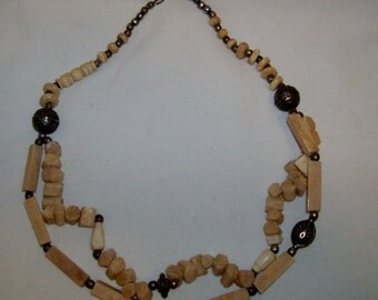 Beautiful multistrand carved  necklace with brass beads,disk
