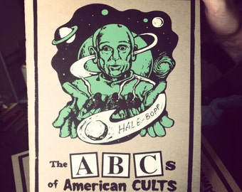 JD Wilkes GRIM HYMNS Volume 2 The ABCs of American Cults illustrated alphabet book Limited Edition Alien Green