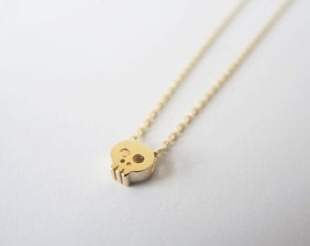 Tiny Skull necklace in Gold