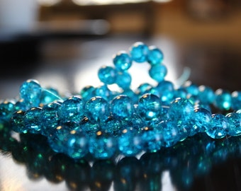 100 approx. aqua 8mm crackle glass beads, 1mm hole