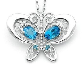 Sterling Silver Butterfly charm w/ Genuine London Swiss Blue Topaz stones.