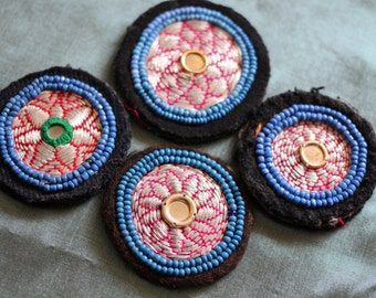 Lot of four vintage sillver embroidered and beaded kuchi disks