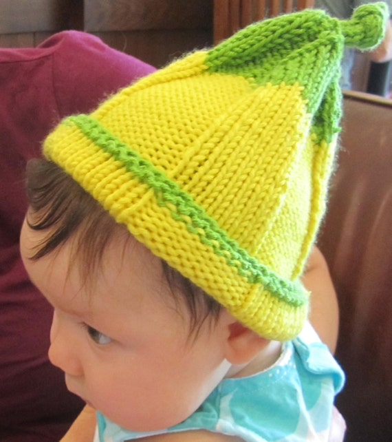 Yellow baby hat that looks like a fruit or vegetable