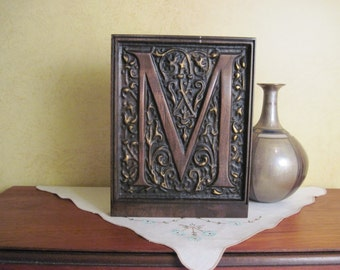 Intricately carved wood monogram letter in walnut using CNC.