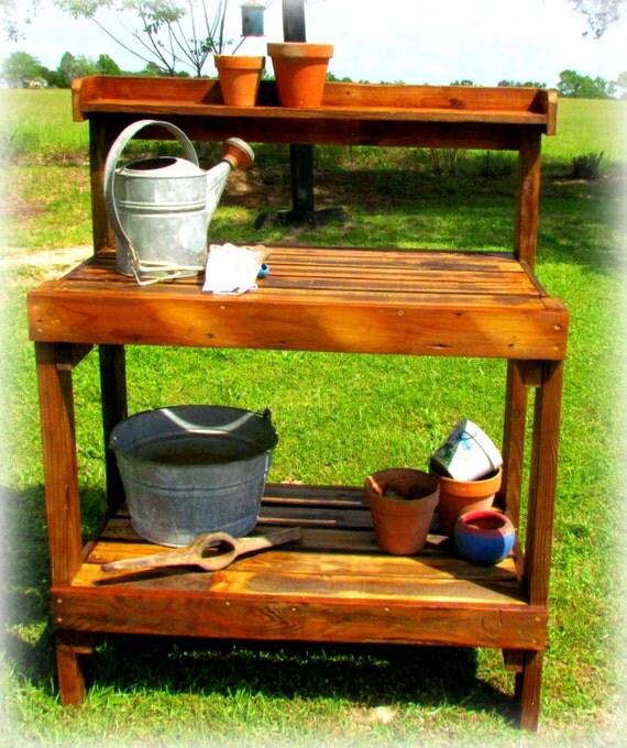 shabby chic upcycled potting bench with upcycled hardware