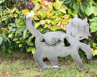 Cat with a belly full of fish. Metal garden art