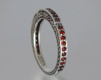 CARYATID wedding band in sterling silver with Garnet