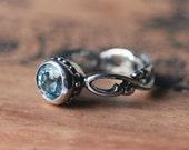 Blue aquamarine ring - March birthstone - infinity engagement ring - renaissance ring - artisan metalsmith - custom made to order - Wrought