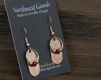 Dangly copper patterned  earrings with red and silver beads