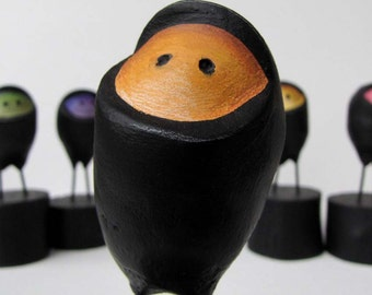 Paper Mache Orange Ninja Easter Egg  on wooden block