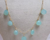 Aqua blue chalcedony tear drops on a gold filled chain necklace