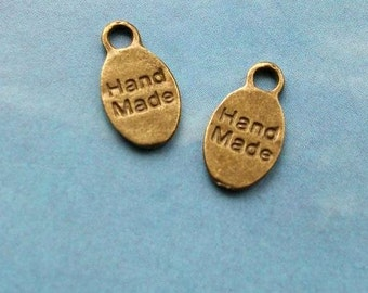20 oval 'hand made' charms, bronze tone, 15mm