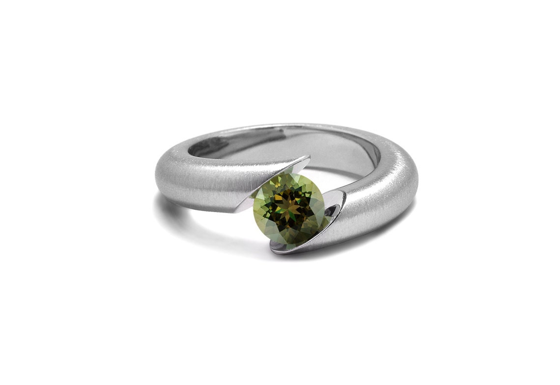 unique peridot tension set ring tapered mounting in
