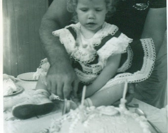 Birthday Baby Girl Sitting on Table Waiting for Cake to Be Cut Vintage 1940s Black and White Photo Photograph
