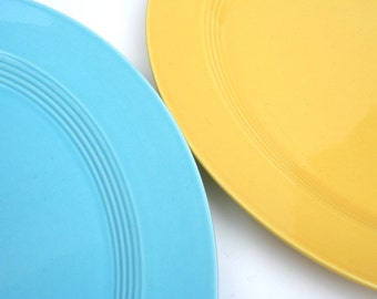 Pair of Harlequin serving plates by Homer Laughlin. Oval, turquoise, yellow, mid century.
