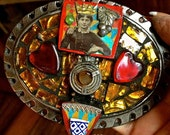 """belt buckle,art,collage of vintage jewelry,tile and glass. she's known as """"Queen Vivian"""" now all you need is a belt. peace."""