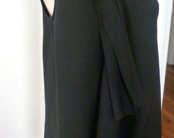 Black Ponte front drape tunic with high neckline.sleeveless/ with raw edge