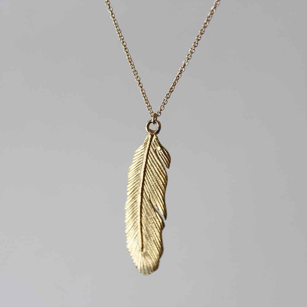 delicate feather pendant brass with 14k gold fill dainty