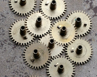 Vintage clock brass gears -- set of 12 -- D12