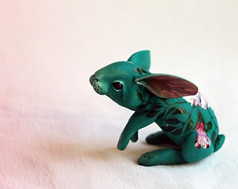 Delicate rabbit with a light pink hibiscus . Polymer clay miniature by Madre Olius