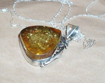 Flowers and the sun Amber Pendant Necklace