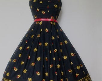 Vintage 1950s Novelty print . Strapless. Black.Red. Yellow Belted. Holiday Party. Rockabilly. Swing Dress.XS