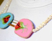 Embroidered Necklace Longing: Blue and Pink kissy mouths with tentacles