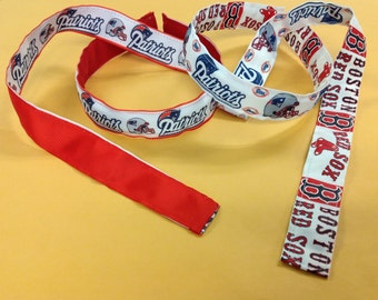 Headbands with reversible Patriots and Red Sox covers.