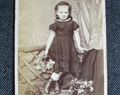 Victorian Carte de Visite Photograph of a Confident Girl with Flower Basket