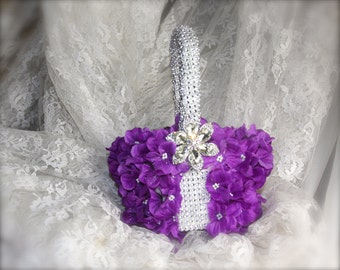 flower girl basket with hydrangea petals and brooches for wedding and keepsake that is vintage inspired