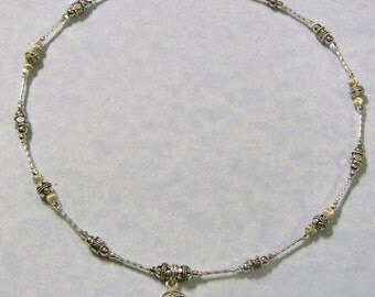 Hammered Dot Silver Hamsa Pendant on Necklace of Silver Tubes and Hammered Dot Beads