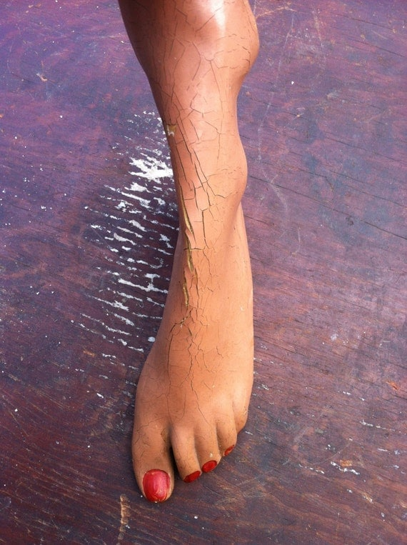 mannequin foot with red toe polish