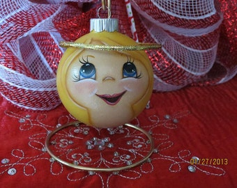 Angel Ornament with blond hair.  Handpainted glass ornament.