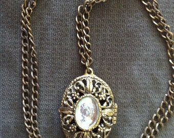 Beautiful antique gold / bronze  tone metal locket with a glass cameo