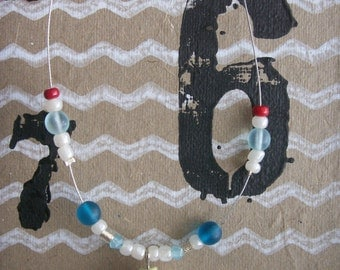 Blue cupcake necklace.