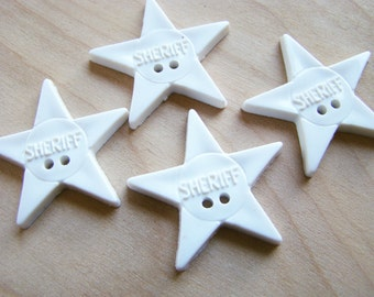 Four Plastic Sheriff Buttons - White