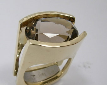 Smoky Quartz tension set into Hand Made and Hammer Forged 18k gold Engagement Ring