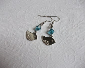 Silver bird earrings with aquamarine crystal