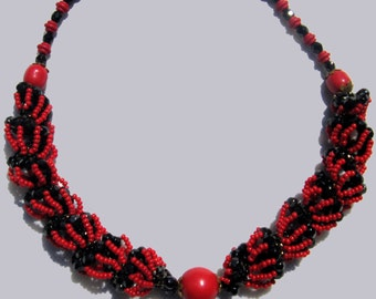 Red and black Czech glass and seed bead spiral necklace