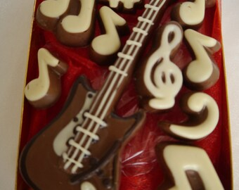 Hand-made Belgian chocolate electric guitar and musical notes