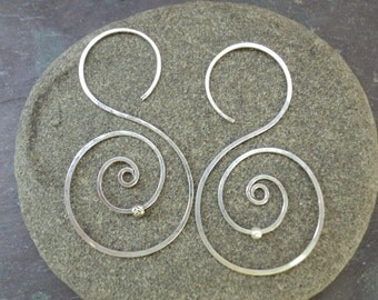 Sterling silver hand-hammered abstract S shape threader earrings with silver beads. Medium sized one-piece earrings for women and teens.