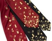 "Pill tie, men's necktie. ""Pill Spill."" Gold capsule & tablet print. Choose standard-wide, narrow or skinny size. Silkscreened microfiber."