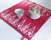scarlet red cotton tea towel with batik spires
