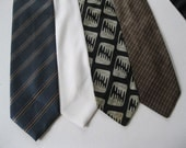 Set of 4 Mens Neckties - Blue striped, White, Black and lt. Gray pattern,Green,Tan and Red Stripe