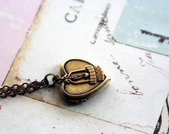 wishing well. locket necklace. brass ox