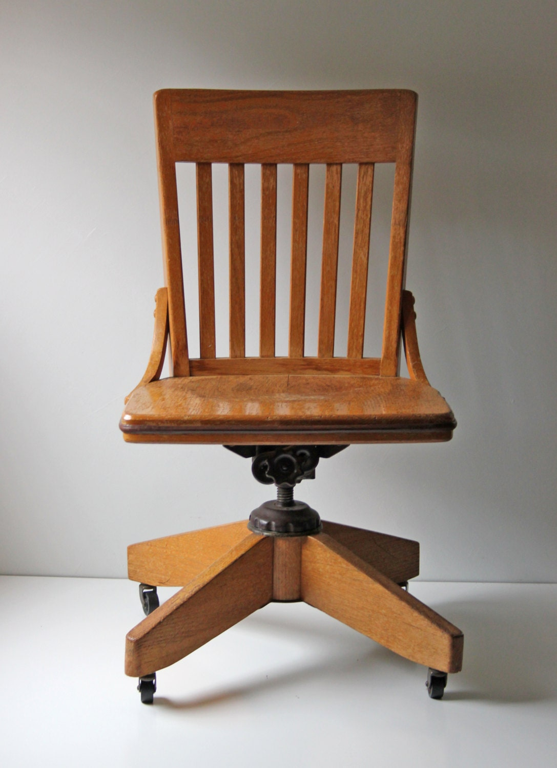 reserved vintage oak office chair on casters